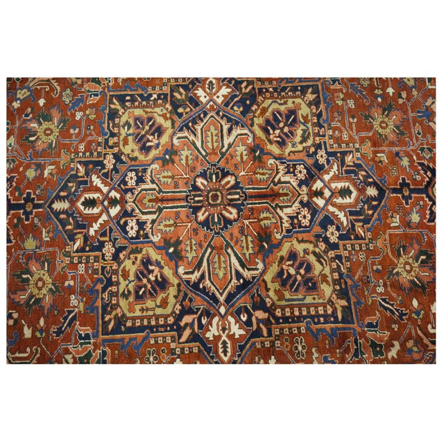 This beautiful rug is hand made, %100 wool pile, made in Iran, Heriz region. It features a geometric pattern in a vibrant...