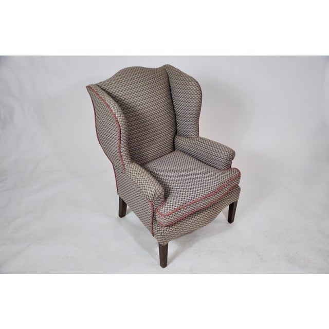 Stunning French Bergere chair newly upholstered in multicolored Cotton fabric. Wonderful petite scale that would work in...