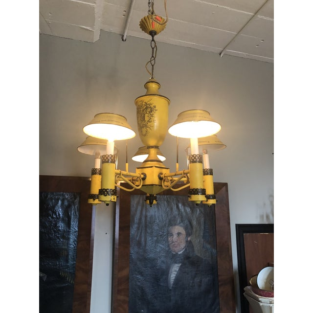 Early 20th Century French Reproduction Regency Yellow Tole Five Light Chandelier. This chandelier is in working,...