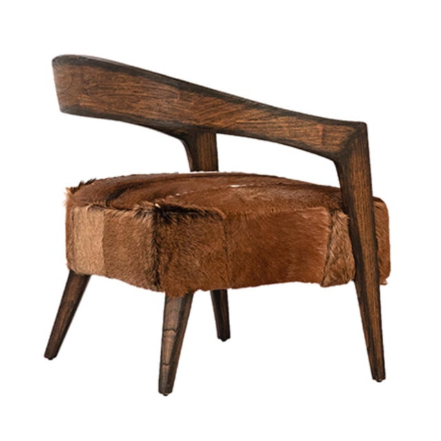 """Horseshoe wood frame arm chair with goat fur upholstered seat. Each unique in goat fur pattern. Seat height is 19""""."""