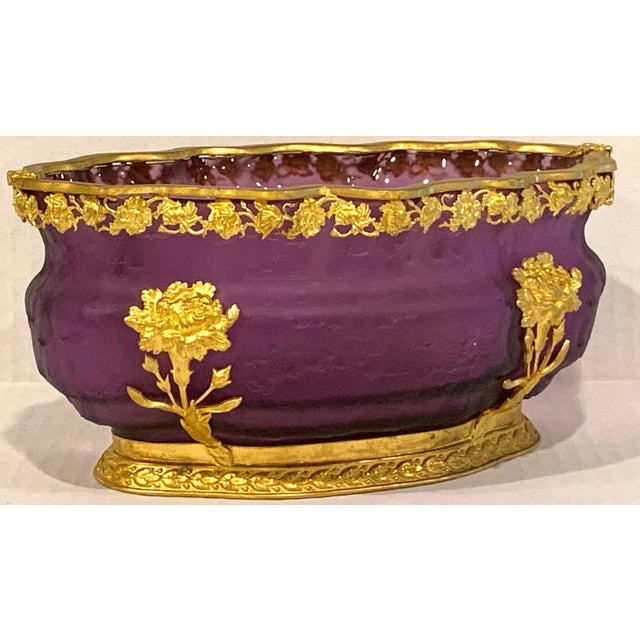 """Ormolu-mounted Baccarat amethyst chipped ice centerpiece, of oval form with floral ormolu mounts, interior measures 8.5""""..."""