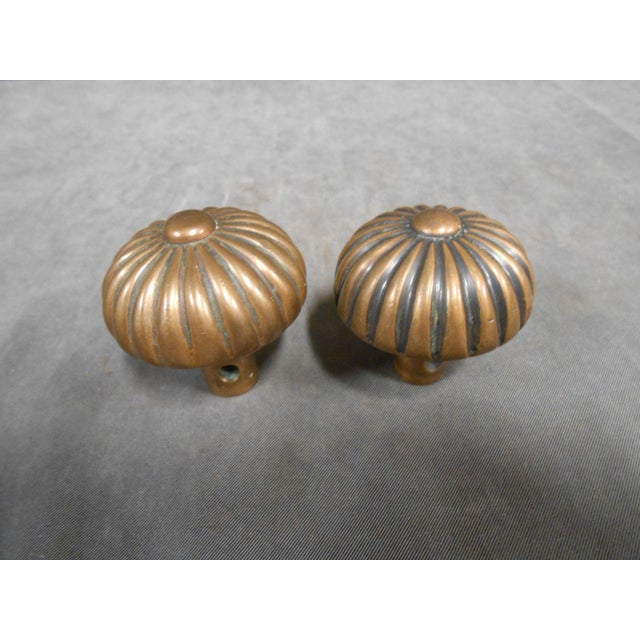 Beautiful pair of antique Art Deco rosette / sea urchin / sunburst pedal door knobs. With all the signs of use and wear...