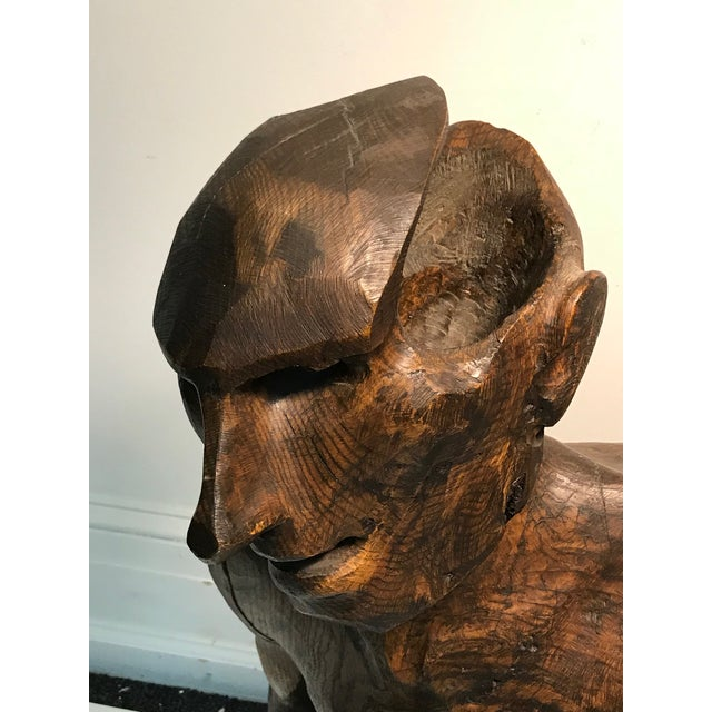 "Dramatic sycamore wood sculpture of a man's figure unsigned with great detail. Measuring 25"" W by 35"" high and 18"" depth...."