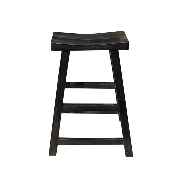 This is a simple wood stool with a tall height no back. The surface is finished with distressed semi-gloss black color....