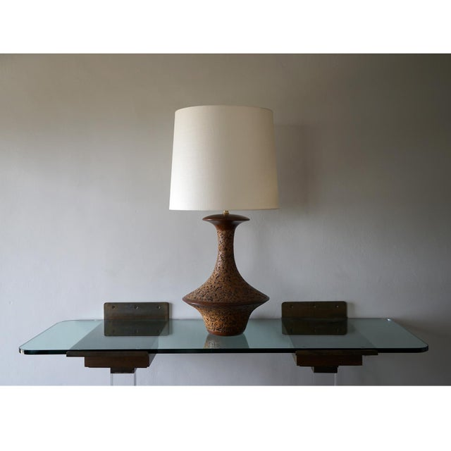 Spun Walnut and Cork Table Lamp 1960s cork, walnut and brass table lamp accompanied by an off white linen drum shade....