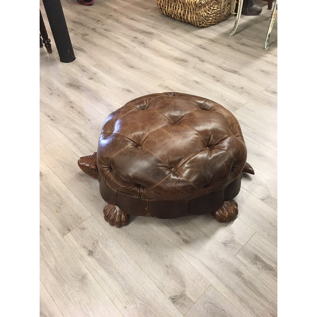 Tufted brown leather turtle ottoman. very unique!