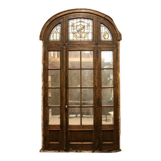 Antique Tall Glass French Doors With Stained Glass Arched Transom With Fleur De Lis For Sale