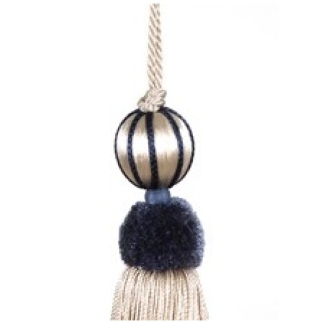 Chic beaded key tassel connected by a twisted cord that loops over the top. The beaded moulds are covered with a cream...