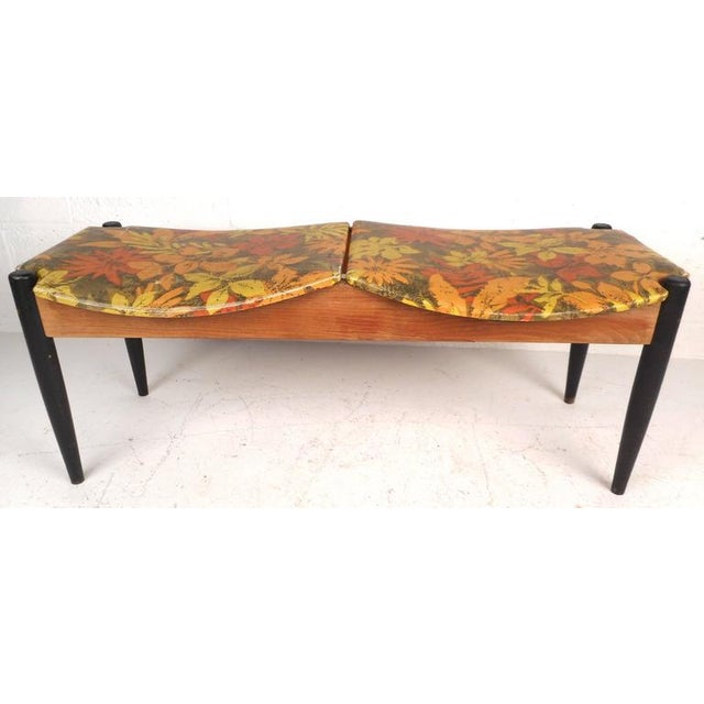 Stunning vintage modern window bench features black tapered legs and two unique sculpted seats with lovely floral...