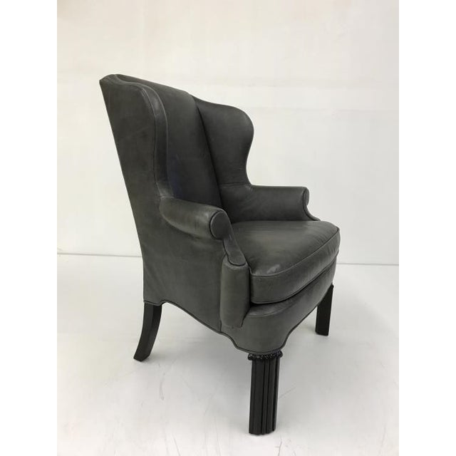 The Shane Wing Chair is a first quality market sample that features an Ultra Plush Seat Cushion. It comes in a Gray...