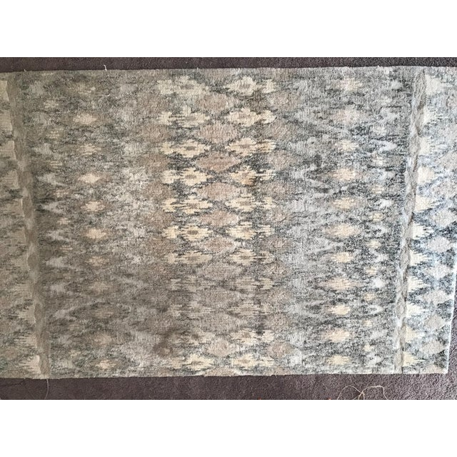 Up for sale is a Handcrafted Ikat Wool Area Rug - by West Elm.