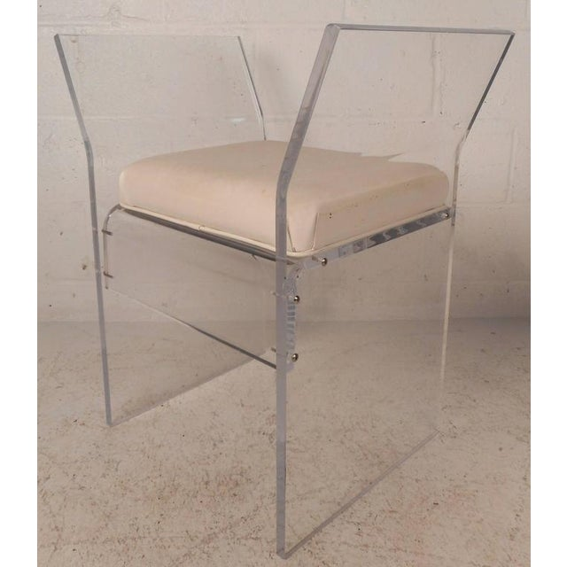 Beautiful vintage modern bench or stool features unusual winged Lucite sides designed for optimal comfort. Elegant white...
