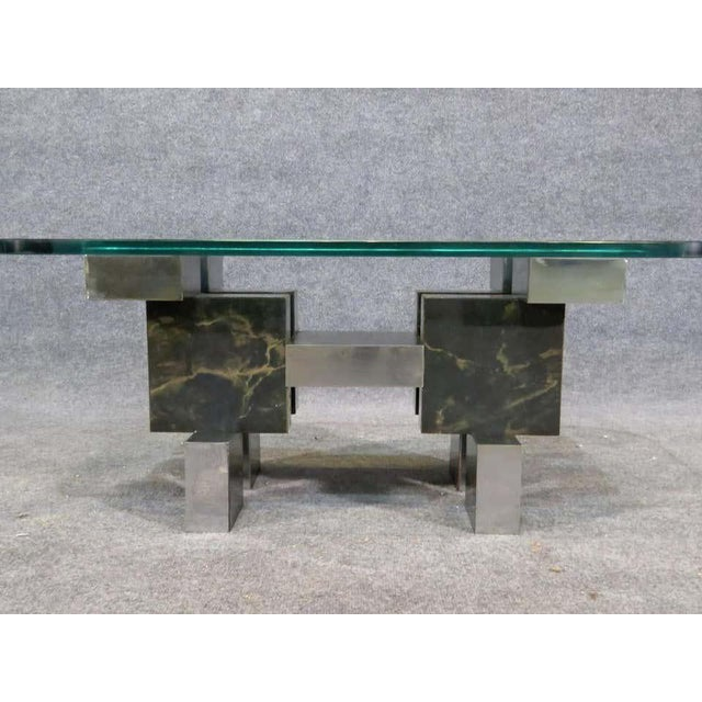 Mid-Century Modern table with city scape style chrome base and thick glass top. (Please confirm item location - NY or NJ -...