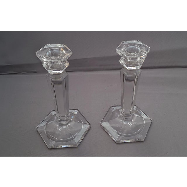 Great small pair of glass tabletop candlestick stands. Manufacturer unknown. Very good condition. Measures 6.C H X 3/5...
