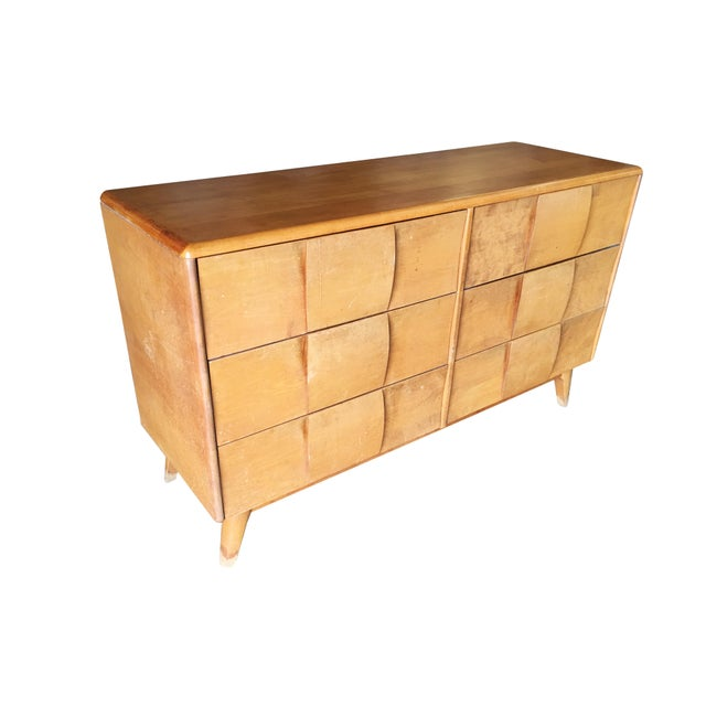 """Heywood-Wakefield """"Sculptura"""" 6 -drawer dresser with extra-wide drawers, sculpted front, and tapered legs all finished in..."""