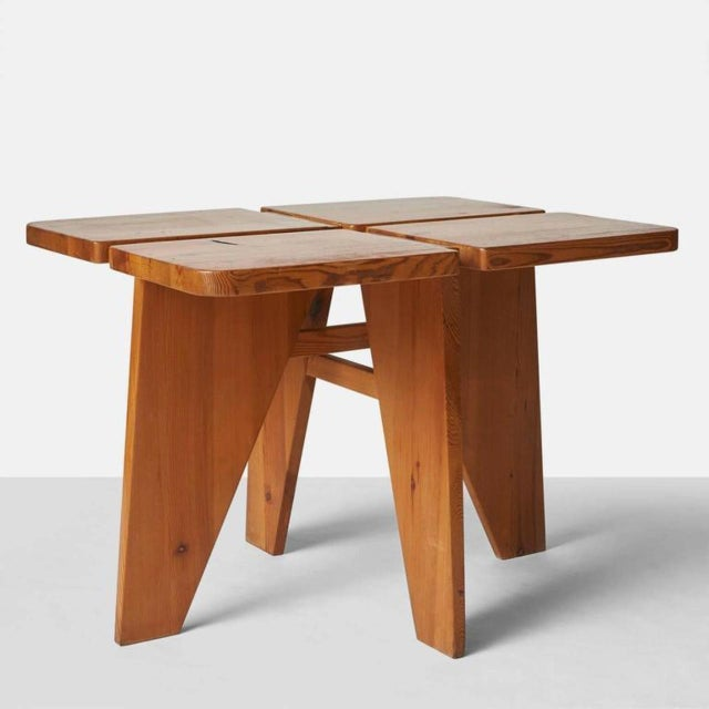 A dining table and four stools in pine, by Lisa Johansson-Pape for Stockman Orno, Finland, 1960s. Each stool measures 14″...