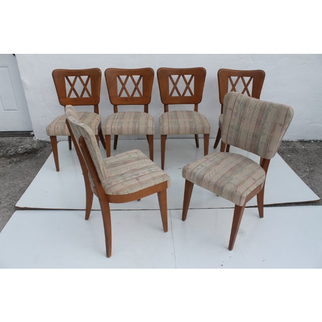 Set of six vintage Heywood-Wakefield Dog Bone dining chairs. Features wonderful period styling with tapered legs, dog...