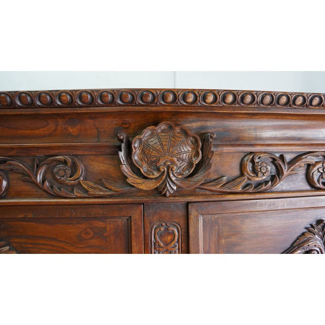 The French countryside and a grand chateau come to mind when looking at this lovely cabinet. This French reproduction...
