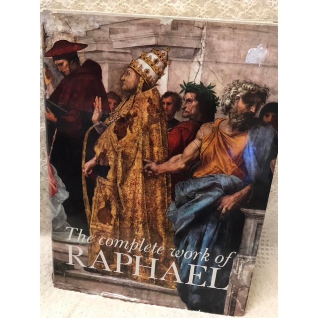 Great and stunning book the complete work of Raphael. 49 full color plate and 875 illustration in black and white. 649 paged