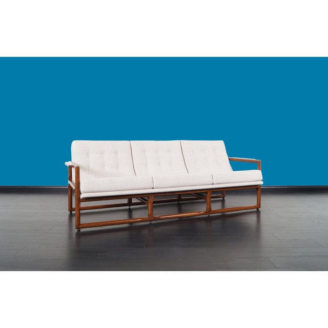 """Mid century """"Cube"""" sofa designed by Milo Baughman, circa 1970s. Solid oak frame refinished in a walnut tone. Tufted scoop..."""