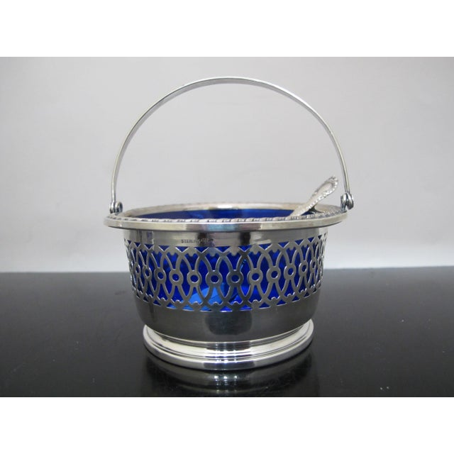 Beautiful antique sterling, silverplate, and blue glass condiment set. Pepper shaker and salt cellar in ornate sterling...