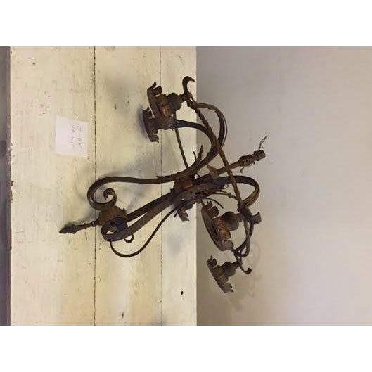 Brighten up your room with this attractive, 5 light, iron chandelier. Overall excellent condition with some white paint...