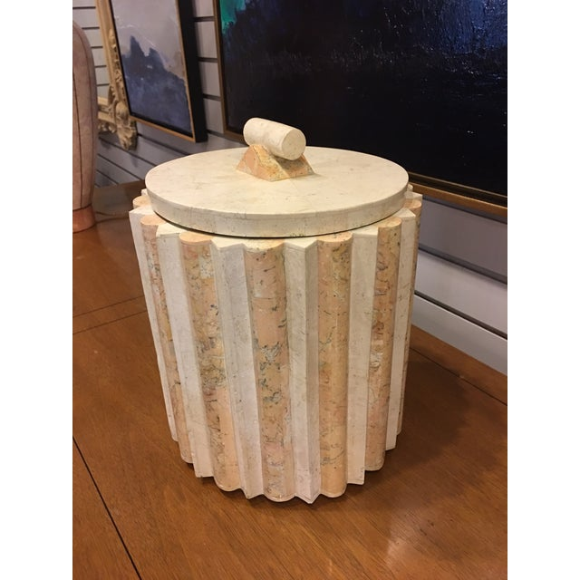 This vintage ice bucket appears to be made of Tennessee pink marble. It has a heavy marble-top, and insulated interior,...