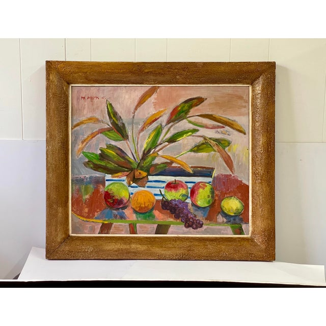 Cheery and bright original 20th Century abstract still life oil painting having a blush background with a midcentury table...
