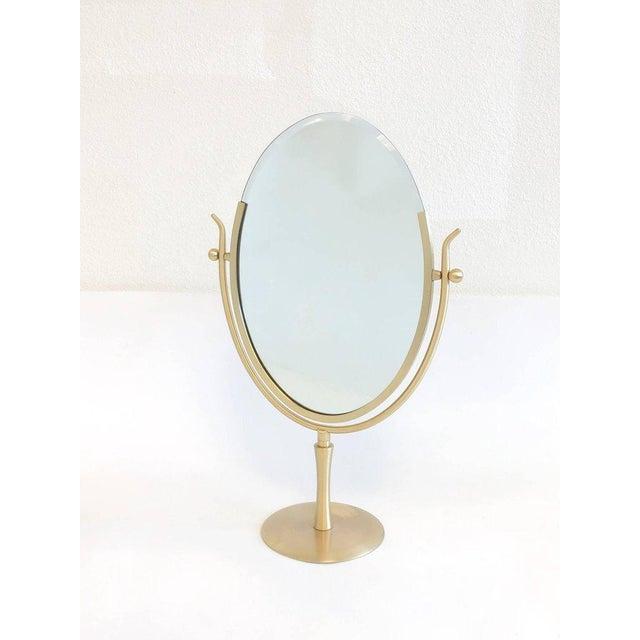 "A glamorous 1970s large satin brass ""Wishbone"" vanity mirror by renowned America designer Charles Hollis Jones. Newly..."