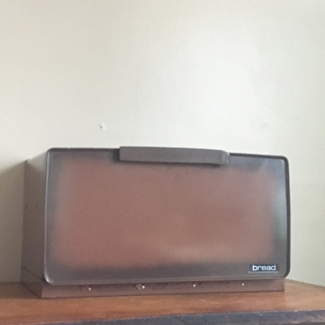 Super cool vintage breadbox in a classic shade of vintage brown. The body itself is in great condition for its age and...