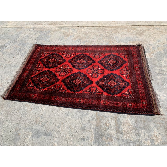Excellent handwoven oriental rug originating from Afghanistan. Color is very rich and vibrant and in primo condition....