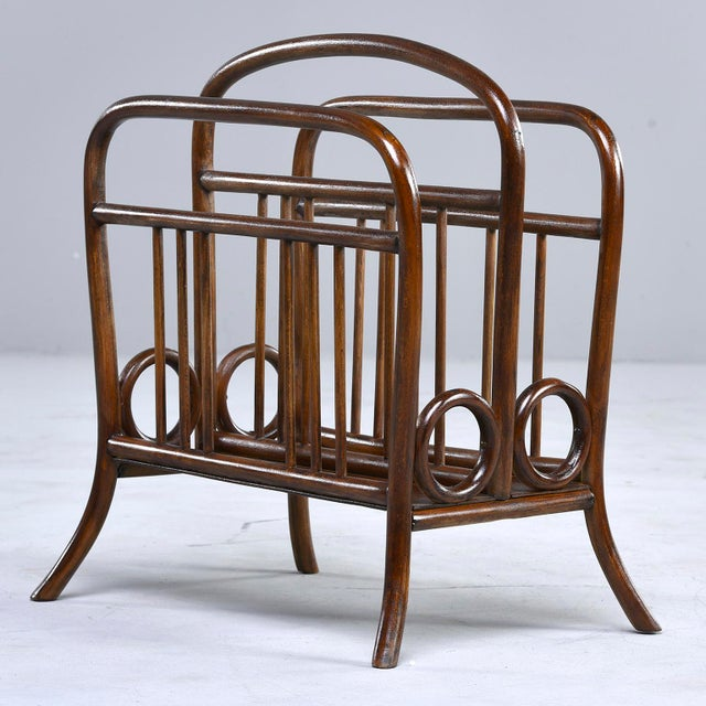 Thonet circa 1920 bentwood magazine rack features its original dark stained bent beechwood in a classic design with...