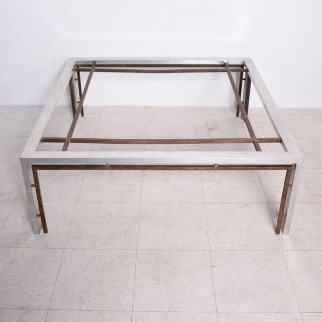 For your consideration, a large coffee table in square shape. Constructed with aluminum, bronze and glass top. Glass top...