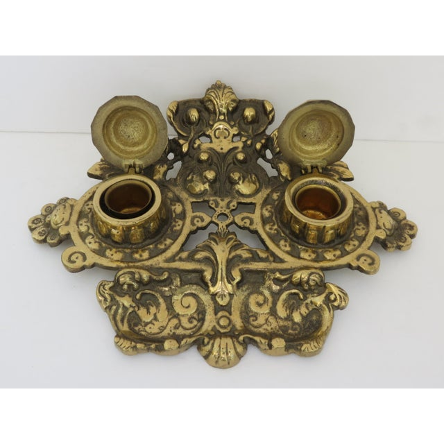 "A beautiful ornate brass inkwell. Marked ""Japan""."