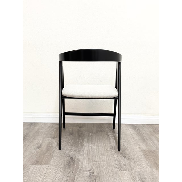 Set of four vintage Italian dining chairs professionally refinished and reupholstered, stamped Made in Italy.