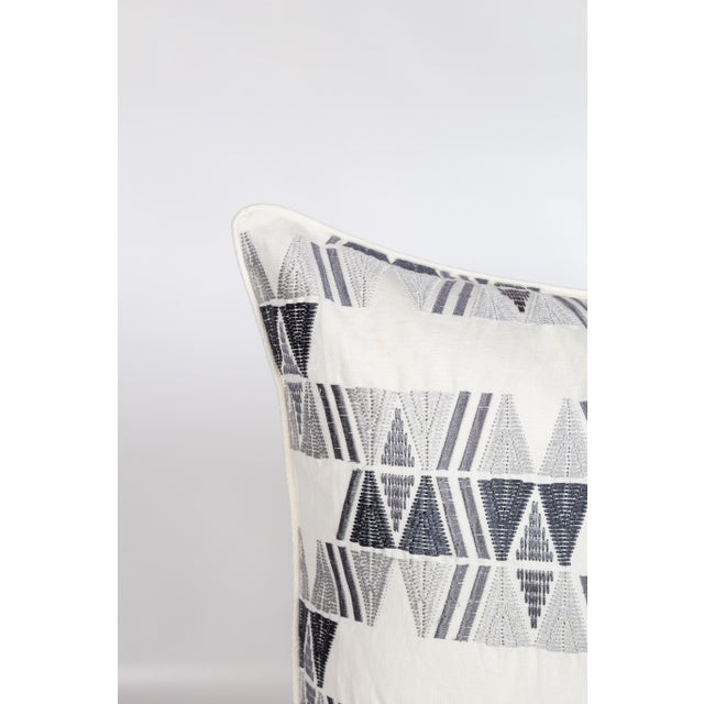 Pair of custom gray-and-ivory linen-blend geometric embroidered pattern pillows. Solid coordinating ivory backs and...