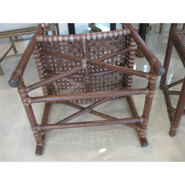 This listing consist of a pair of McGuire leather straps and bamboo chairs. They are in great shape with no damage. They...