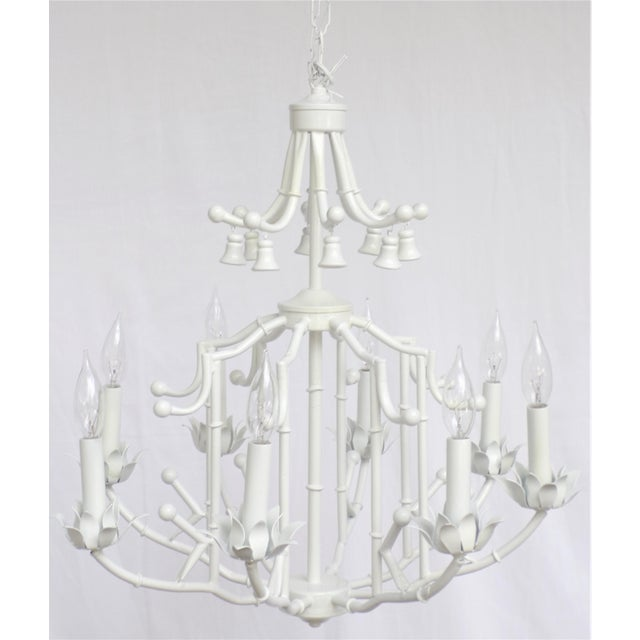 This is large mid-century 8 arm Palm Beach Regency Faux Bamboo Tole Chandelier. This faux bois fixture has a whimsical...