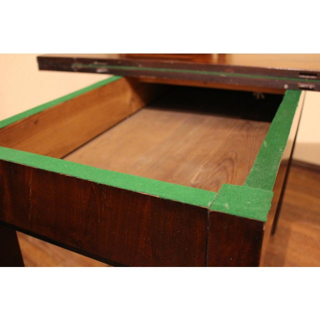 A Neo-Classical French games table, late 18th century. Mahogany with plum pudding mahogany top. Decorative mid-apron...