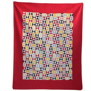 Vibrant Mini-Peiced Hour Glass Crib Quilt