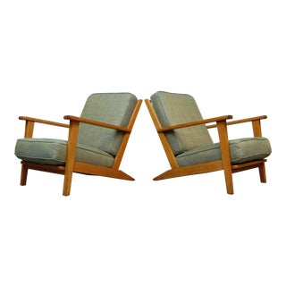 Pair of Modernist Lounge Chairs From France For Sale