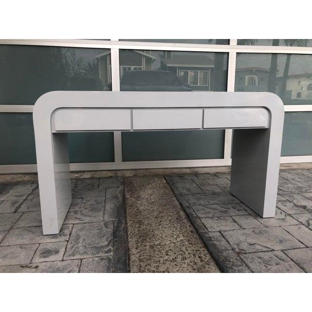 Vintage 1980s light gray laminate waterfall desk with 3 desk drawers. Some minor scuffs, nicks, and scratches to the...