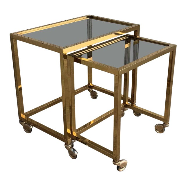 Nesting Tables Italian Design 1970 in Brass With Smoked Glass and Wheels - a Pair For Sale