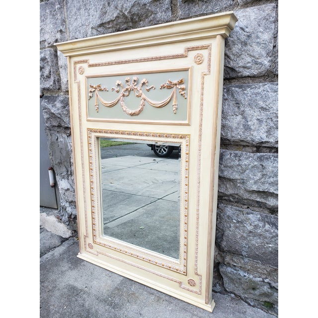 This is avery large scale French Provincial style mirror featuring very soft colors and beautiful details all around. The...