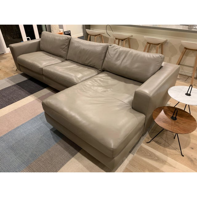 """Only 2 years old and in excellent condition. This is the gray kalahari leather, right-oriented chaise with the 4"""" tubular..."""