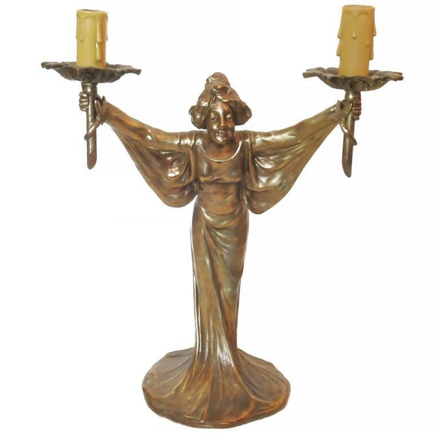Bronze Art Nouveau style figural female candlestick candelabra lamp pair featuring a solid bronze casted figural female...