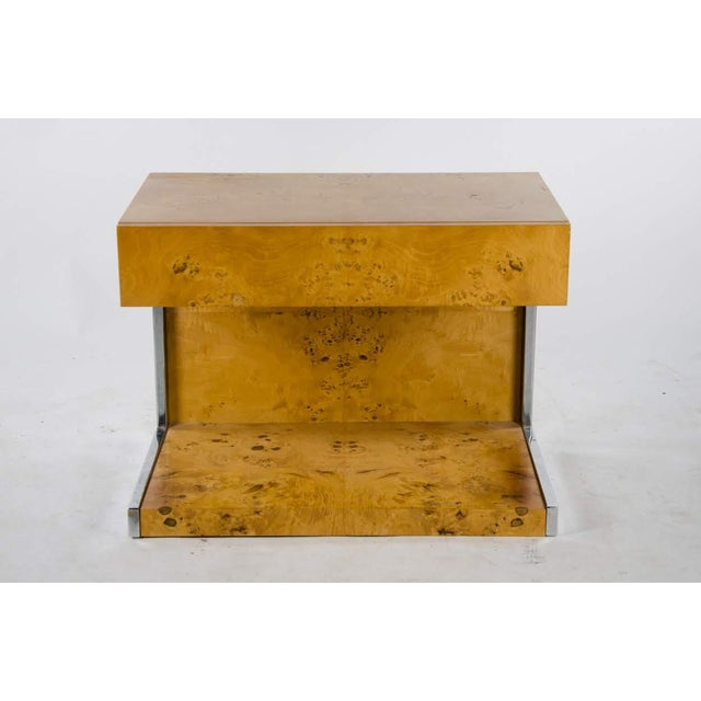 Introduce the perfect balance of modern style with industrial flair with this fantastic 1990's Modern burl walnut...