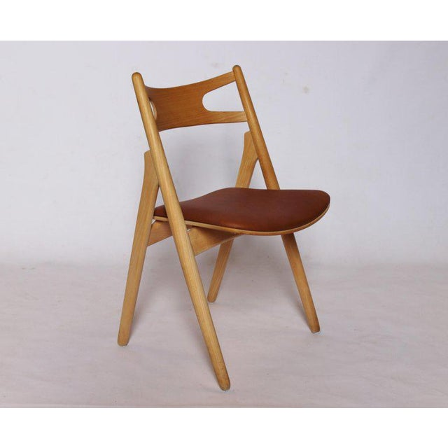 A Sawbuck chair, model CH29, designed by Hans J. Wegner in 1952 and manufactured by Carl Hansen & Son in the 1970s. The...