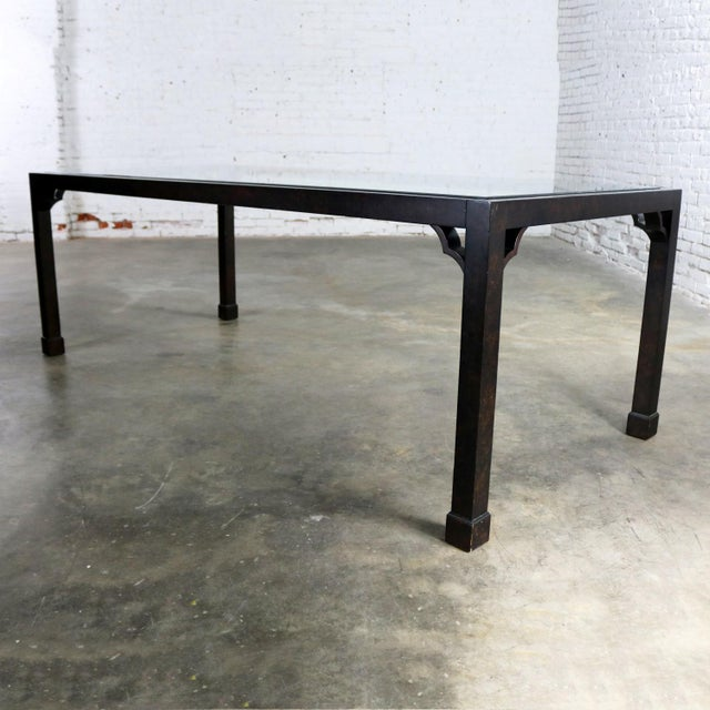 Handsome vintage Chinoiserie Parsons style dining table in a faux tortoiseshell oil drop finish with a beveled glass...