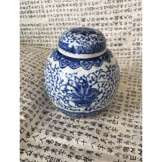 This is a small Chinese blue and white storage or ginger jar with matching lid. There are no marks. Sometimes these jars...